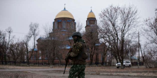 A Ukrainian serviceman patrols the center of Trehizbenka village, controlled by Ukrainian government...