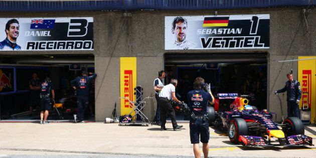MONTREAL, QC - JUNE 07: Sebastian Vettel of Germany and Infiniti Red Bull Racing drives out of the team...