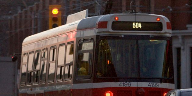 TTC_BW03_012706_ Early morning commuters board the 504 streetcar at King St. E. at Dufferin, January...