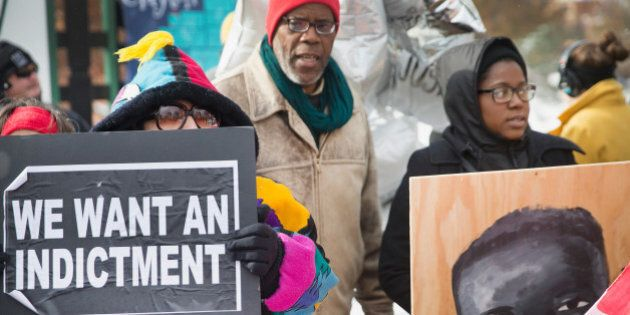 CLAYTON, MO - NOVEMBER 17: Demonstrators mark with a protest the 101st day since 18-year-old Michael...