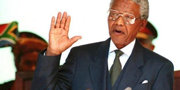 (FILES) A file photo showsing South African President Nelson Mandela taking the oath 10 May 1994 during...