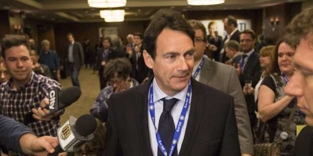 Pierre Karl Peladeau enters the Parti Québécois rally April 6, 2014 as he wins in St-Jerome but the Parti...