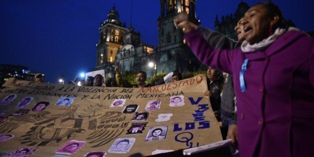 People demonstrate against the presumed massacre of 43 students, in Mexico City, on November 20, 2014....