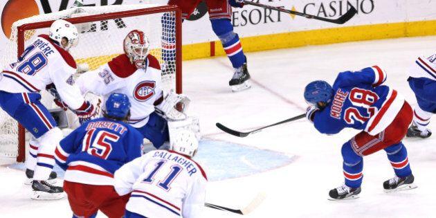 NEW YORK, NY - MAY 29: Dominic Moore #28 of the New York Rangers scores a goal against Dustin Tokarski...
