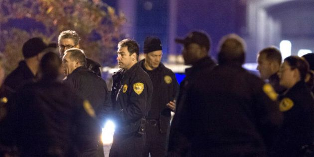 Tallahassee police chief Michael Deleo, center, talks with his officers as they investigate a shooting...