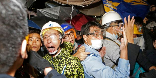 Pro-democracy protesters confront police officers outside the Legislative Council in Hong Kong early...