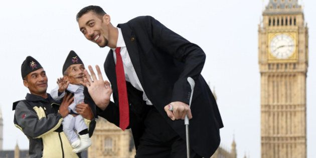 LONDON, ENGLAND - NOVEMBER 13: The worlds tallest man Sultan Kosen meets with the shortest man ever,...