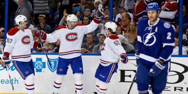 TAMPA, FL - APRIL 16: Thomas Vanek #20 of the Montreal Canadiens (C) celebrates his goal with teammates...