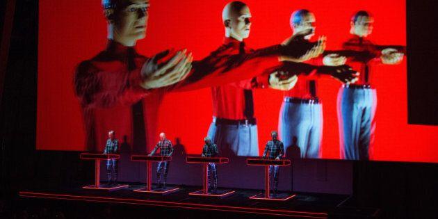 PARIS, FRANCE - NOVEMBER 06: Ralf Hutter, Fritz Hilpert, Henning Schmitz and Falk Grieffenhagen from Kraftwerk perform at Fondation Louis Vuitton on November 6, 2014 in Paris, France. (Photo by David Wolff - Patrick/Getty Images)