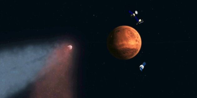 This handout artist's concept provided by NASA/JPL shows the Comet Siding Spring approaching Mars, shown...