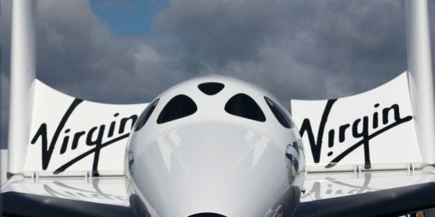 The Virgin Galactic SpaceShipTwo stands outside the company's stand on the third day of the Farnborough...