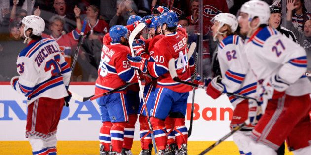 MONTREAL, QC - MAY 27: Rene Bourque #17 of the Montreal Canadiens celebrates his second period goal at 6:54 against the New York Rangers during Game Five of the Eastern Conference Final in the 2014 NHL Stanley Cup Playoffs at Bell Centre on May 27, 2014 in Montreal, Canada.  (Photo by Richard Wolowicz/Getty Images)