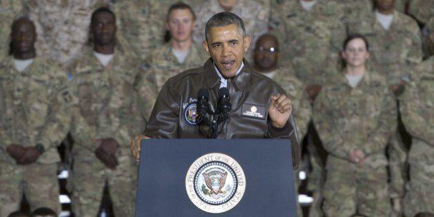 US President Barack Obama addresses US troops during a surprise visit to Bagram Air Field, north of Kabul,...