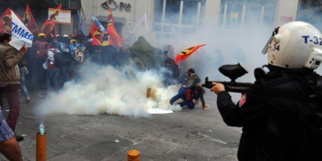 Riot police disperse protestors with tear gas and rubber bullets during a protest at Istiklal avenue...