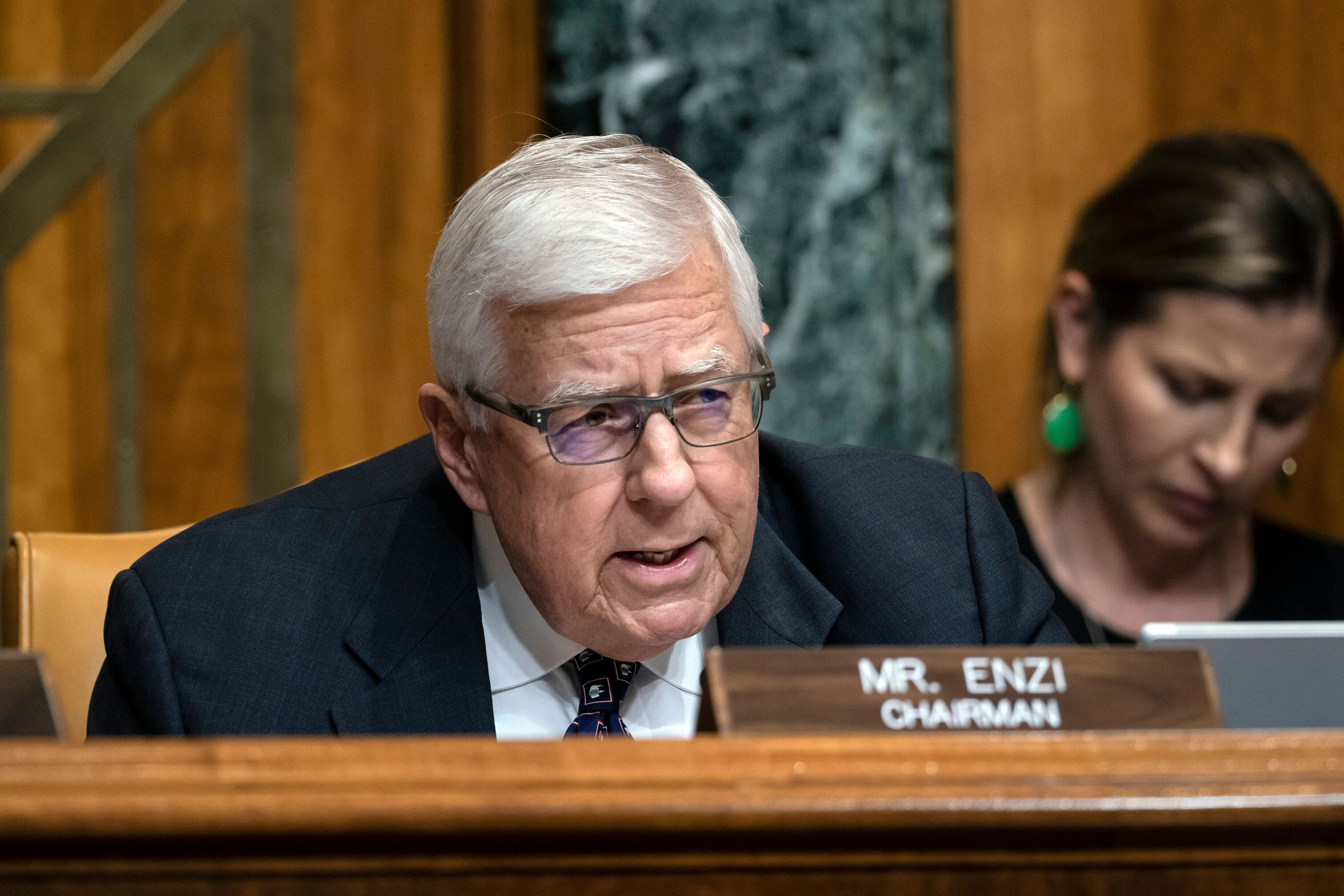 FILE - In this March 27, 2019 file photo, Sen. Mike Enzi, R-Wyo., chairman of the Senate Budget Committee, makes an opening statement on the fiscal year 2020 budget resolution, on Capitol Hill in Washington.  Enzi announced Saturday, May 4  that he will not run for a fifth term in 2020. The 75-year-old made the announcement in his hometown of Gillette. (AP Photo/J. Scott Applewhite, File)