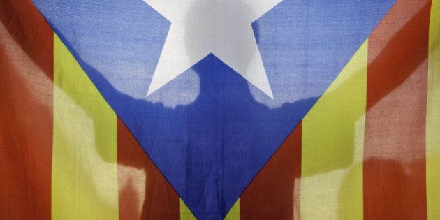 BARCELONA, SPAIN - OCTOBER 2: A protestor holds a 'Estelada' the Catalan independentist flag as 'Students...