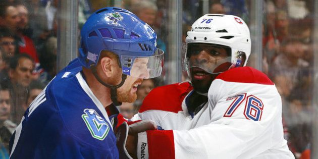 VANCOUVER, BC - OCTOBER 30: Daniel Sedin #22 of the Vancouver Canucks and P.K. Subban #76 of the Montreal...