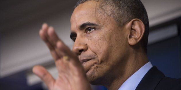 US President Barack Obama makes a statement on Iraq from the press briefing room at the White House in...