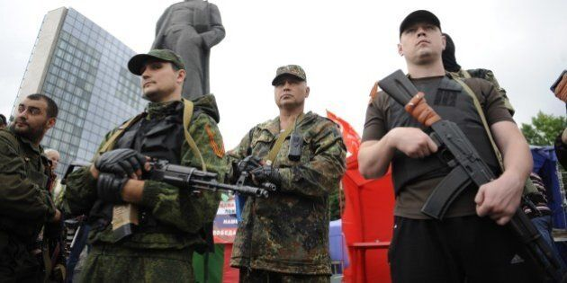 Pro-Russian militants take the military oath of allegiance to the so-called People's Republik of Donetsk...