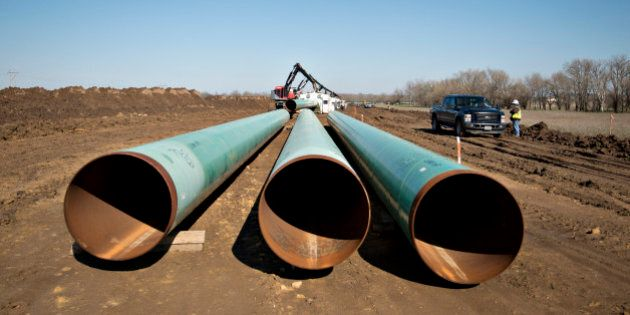 Three sections of pipe sit on the ground during construction of the Gulf Coast Project pipeline in Atoka, Oklahoma, U.S., on Monday, March 11, 2013. The Gulf Coast Project, a 485-mile crude oil pipeline being constructed by TransCanada Corp., is part of the Keystone XL Pipeline Project and will run from Cushing, Oklahoma to Nederland, Texas. Photographer: Daniel Acker/Bloomberg via Getty Images