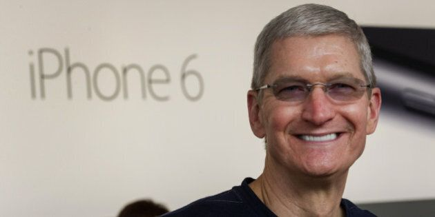 Tim Cook, chief executive officer of Apple Inc., stands for a photograph during the sales launch for the iPhone 6 and iPhone 6 Plus at the Apple Inc. store in Palo Alto, California, U.S., on Friday, Sept. 19, 2014. Apple Inc.'s stores attracted long lines of shoppers for the debut of the latest iPhones, indicating healthy demand for the bigger-screen smartphones. The larger iPhone 6 Plus is already selling out at some stores across the U.S. Photographer: David Paul Morris/Bloomberg via Getty Images