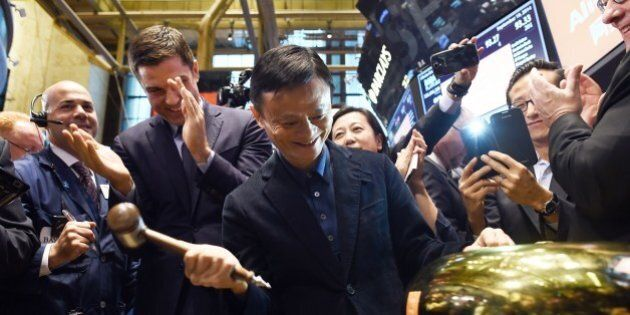 Chinese online retail giant Alibaba founder Jack Ma rings a bell to open trading on the floor at the New York Stock Exchange in New York on September 19, 2014. A buying frenzy sent Alibaba shares sharply higher Friday as the Chinese online giant made its historic Wall Street trading debut. In early trades after the record public share offering, Alibaba leapt from an opening price of $68 to nearly $100 and, while it dropped back, was still up some 38 percent at $94.08 after 10 minutes. AFP PHOTO/Jewel Samad        (Photo credit should read JEWEL SAMAD/AFP/Getty Images)