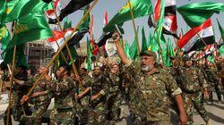 Irak: des miliciens chiites paradent