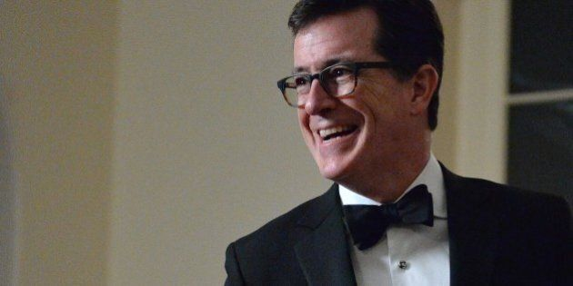 Comedian Stephen Colbert arrives at the White House in Washington on February 11, 2014 for the state...