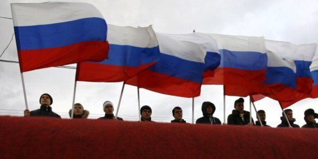 Pro-Kremlin activists rally in southern Russian city of Rostov-on-Don, on March 18, 2014, to celebrate...