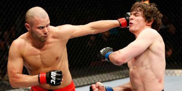 QUEBEC CITY, CANADA - APRIL 16: (L-R) Chad Laprise punches Olivier Aubin-Mercier in their welterweight...