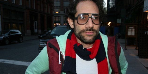 American Apparel CEO Dov Charney wears his clothing line while strolling down the street