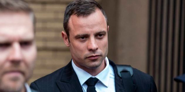 PRETORIA, SOUTH AFRICA - MARCH 13 (SOUTH AFRICA OUT) Oscar Pistorius leaves the Pretoria High Court on...