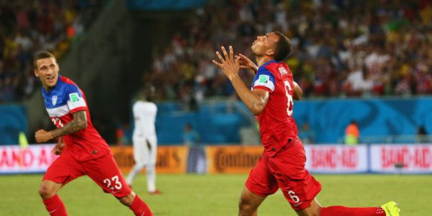 NATAL, BRAZIL - JUNE 16: John Brooks of the United States (R) celebrates scoring his team's second goal...