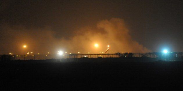 Smoke rises from the Karachi airport terminal after the militants' assault in Karachi on June 9, 2014....