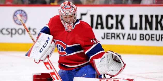 MONTREAL, QC - APRIL 12: Carey Price #31 of the Montreal Canadiens makes a pad save on the puck during...