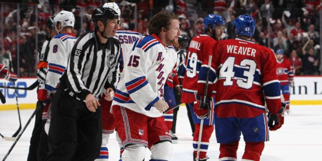 MONTREAL, QC - MAY 27:Derek Dorsett #15 of the New York Rangers is escorted off the ice after loosing...