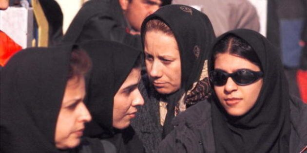 TEHRAN, IRAN: Iranian women cross a street in Tehran 20 February 2000. Results of Iran's 18 February...