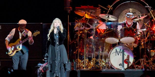 BERLIN, GERMANY - OCTOBER 16: John McVie, Stevie Nicks and Mick Fleetwood (L-R) of Fleetwood Mac perform live during a concert at the O2 World on October 16, 2013 in Berlin, Germany. (Photo by Frank Hoensch/Redferns via Getty Images)
