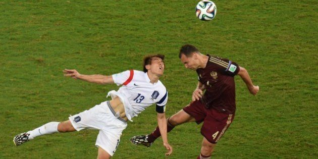 South Korea's forward Koo Ja-Cheol (L) vies with Russia's defender and captain Sergey Ignashevich during...