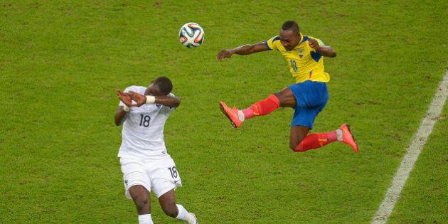 RIO DE JANEIRO, BRAZIL - JUNE 25: Moussa Sissoko of France and Walter Ayovi of Ecuador compete for the...