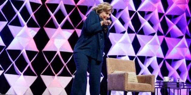 LAS VEGAS, NV - APRIL 10: Former Secretary of State Hillary Clinton ducks after a woman threw an object...
