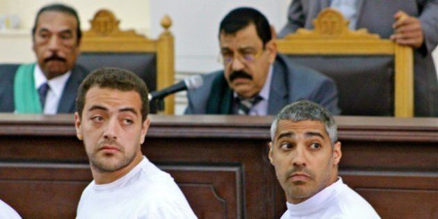 Cameraman Baher Mohamed, left, and Mohamed Fadel Fahmy, the Cairo bureau chief for al Jazeera English,...