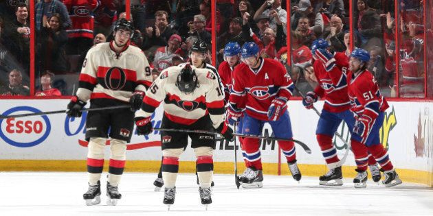 OTTAWA, ON - APRIL 4: Mika Zibanejad #93 and Zack Smith #15 of the Ottawa Senators react as Thomas Vanek...
