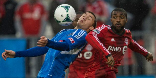 TORONTO - OCTOBER 26 - Montreals Andrew Wenger controls the ball in front of Doneil Henry of TFC. Toronto...