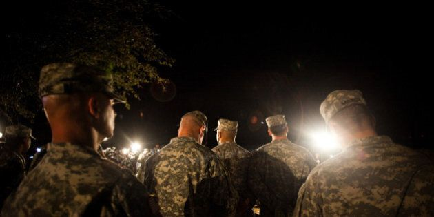 FORT HOOD, TX - APRIL 2, 2014: Soldiers watch over General Mark Milley, III Corps and Fort Hood Commanding...