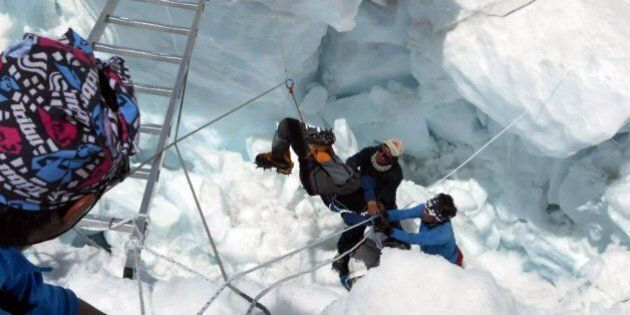 Nepalese rescue team members rescue a survivor of an avalanche on Mount Everest on April 18, 2014. At...