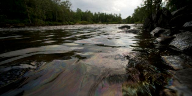 LAC-MEGANTIC QC - JULY 9: Crude oil from the Lac-MÈgantic spill flowed down the ChaudiËre River Tuesday afternoon threatening towns and ecosystems downstream.        (Lucas Oleniuk/Toronto Star via Getty Images)
