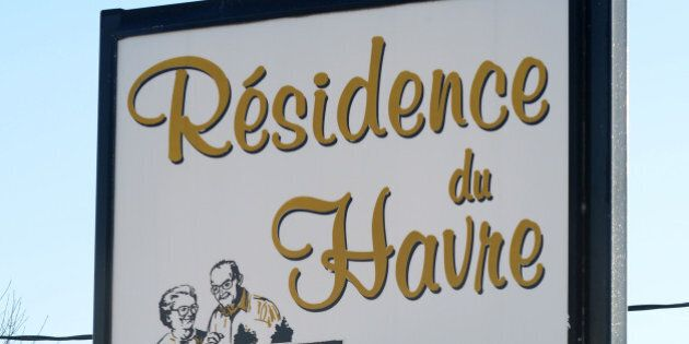 A sign points to the retirement home 'Residence du Havre,' a pharmacy and a grocery store in L'Isle-Verte,...