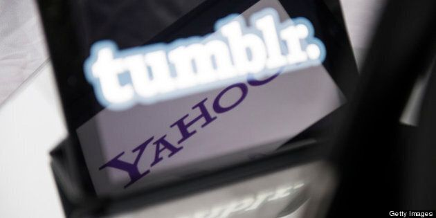 A picture taken on May 20, 2013 in Paris, shows logos of the brands Tumblr and Yahoo! on the screen of...