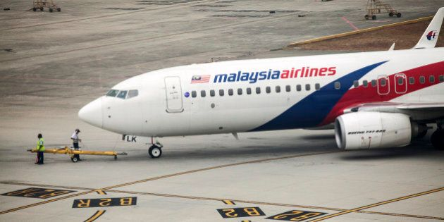 A Boeing Co. 737-800 aircraft operated by Malaysian Airline System Bhd. (MAS) is prepared for take off at Kuala Lumpur International Airport (KLIA) in Sepang, Malaysia, on Friday, March 14, 2014. Indian forces expanded the search for missing Malaysian Airlines Flight 370 to the Bay of Bengal after evidence mounted the plane with 239 people on board may have flown long after controllers lost contact with it a week ago. Photographer: Charles Pertwee/Bloomberg via Getty Images